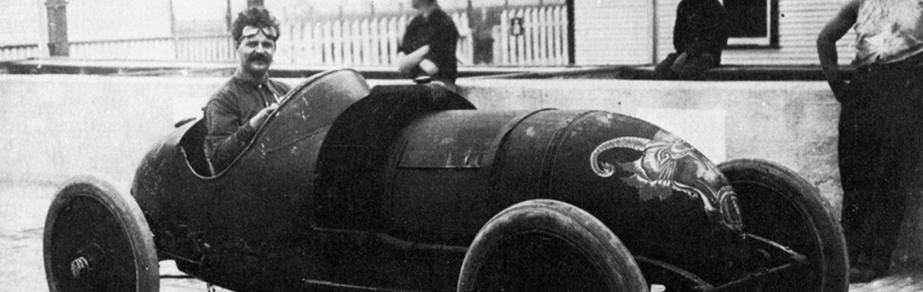 Louis Chevrolet steering a race car